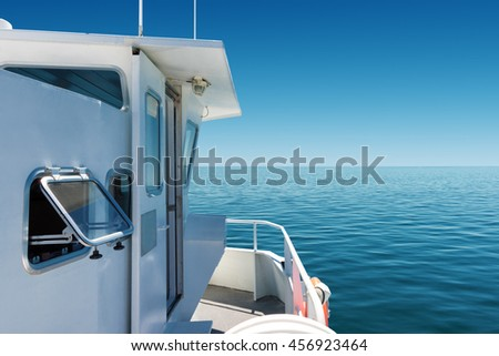on board of a passenger boat navigating on calm blue sea - stock photo