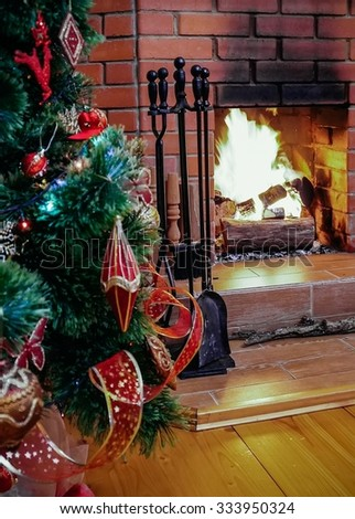 On Christmas evening cozy home fireplace and New Year tree - stock photo