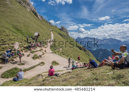 On circular hike around Sass de Putia mountain-August 15, 2016: Hikers taking their breath & resting on Putia pass at 2,357 m after the ascent effort, Dolomites, Trentino, South Tyrol, Italy