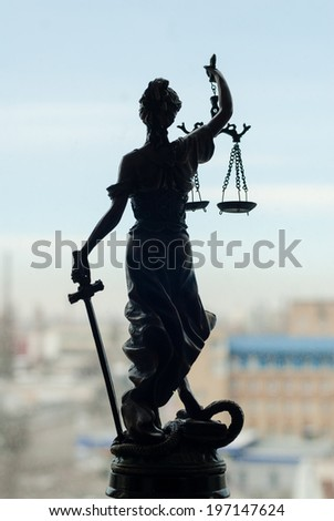 on city outdoors blue sky copy space background picture of back of sculpture of themis, femida or justice goddess  - stock photo