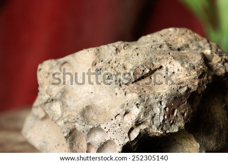 On display is a piece of industrial slag which is used in a variety of places to strengthen foundations for bridges, railroads and many others. - stock photo