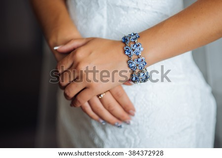 On hand necklace, bracelet with stones - stock photo