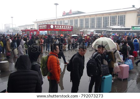 On January 6, 2018 in xian, China, shaanxi railway station waiting for train passengers. Because of the snow all over the world, a lot of people out of the snow up. Travel is such a scenario.