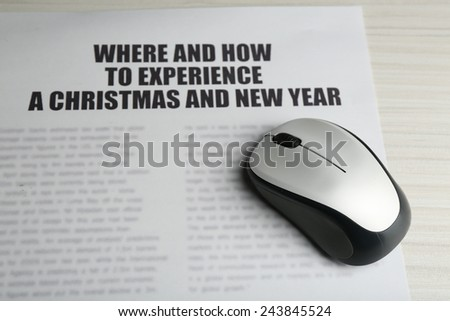 On-line news concept. Computer mouse and newspaper - stock photo