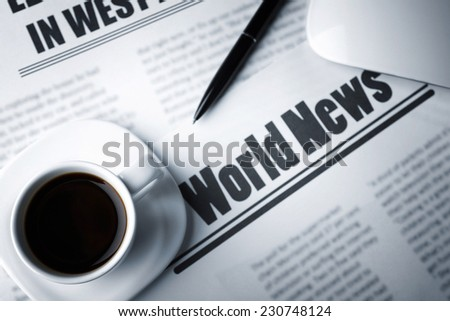On-line news concept. Computer mouse, cup of coffee and newspaper, close-up - stock photo