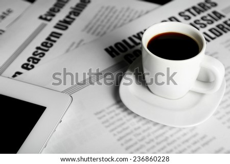 On-line news concept. Computer mouse, PC tablet, cup of coffee and newspaper, close-up - stock photo