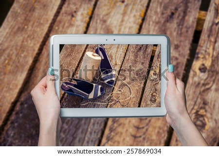 On-line shoe store, she photographed sandals - stock photo