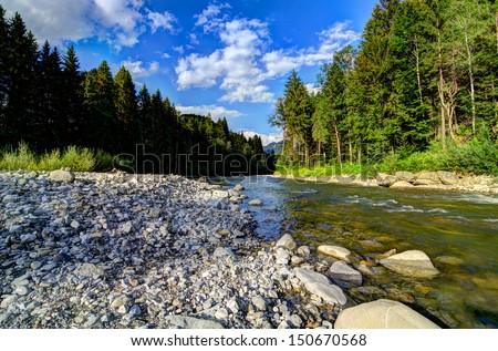 On mountain river - stock photo