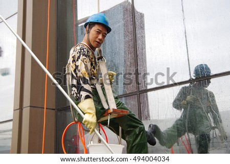 "On October 5, 2016, xi 'an, a high building external wall cleaning workers are doing. These people in China known as the ""spiderman""."