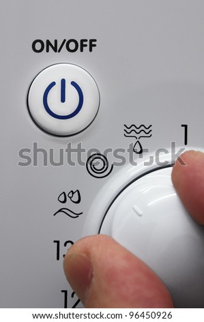On Off button and washing machine dial - stock photo