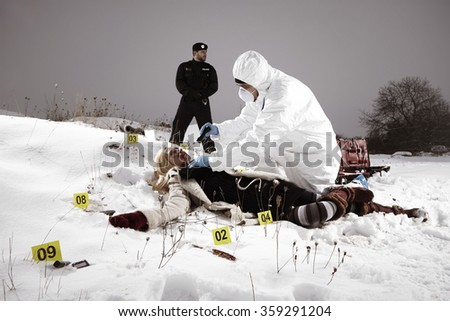 On place of crime - technicians at work - stock photo