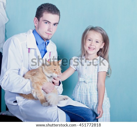 on reception at the vet.Happy little girl stroking her cured the cat that sits on a man's hands vet.toned - stock photo
