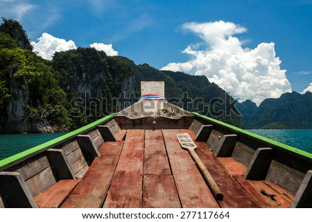 On rowboat to islands with oar - stock photo
