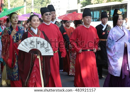 On September 10, 2016 in xian, China, thousands of hanfu fans dressed in traditional costumes, in droves to walk all the way to the wild goose pagoda north square, drew the onlookers.