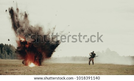 On the battlefield near the soldier explodes mine. Shelling rebels with mortars. Military actions in the movie. Stuntman