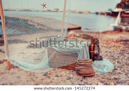 on the bay at the wooden pier fishing nets and marine composition - stock photo