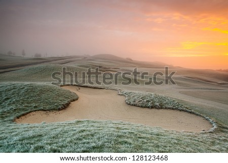 On the empty golf course in winter morning - stock photo