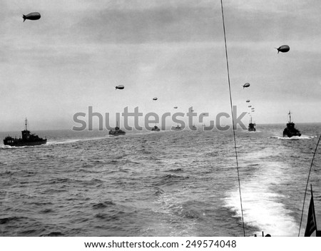 On the English Channel, a convoy in two lines of landing craft head for Utah Beach on D-Day. The craft traveled in paths cleared of mines before the invasion. June 6, 1944. - stock photo