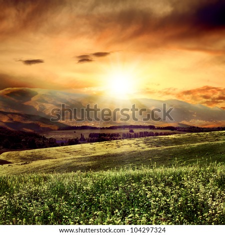 on the evening. rural summer landscape close to high mountain - stock photo