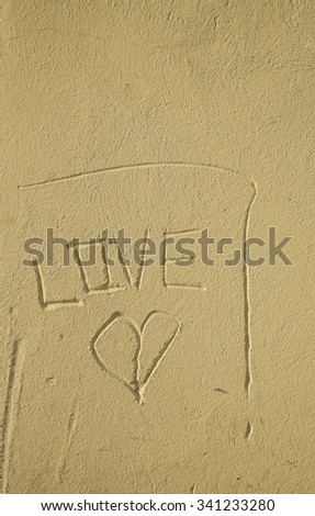 on the facade engraved love message  - stock photo