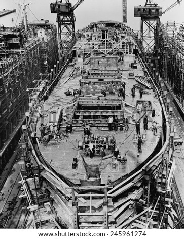 On the fourteenth day of the construction of a Liberty Ship. The upper deck mast houses and after-deck house are in place. Bethlehem Fairfield shipyards near Baltimore Maryland. Ca. 1942-43. - stock photo
