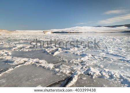 On the ice of the frozen Baikal lake, Siberia, Russia - stock photo
