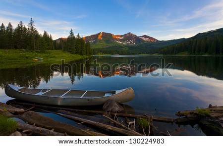On the Loose-- An untended canoe along the shore of Lake Irwin at sunrise, Colorado.