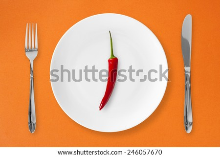 On the plate, hot chili peppers. - stock photo