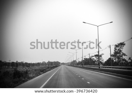 On the quiet road , black and white vignette style - stock photo