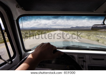 On the road again in the old chevy on an Arizona highway stretching to the horizon - stock photo