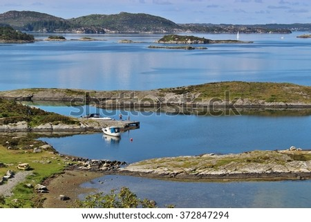 On the road in Norway, from Bergen to Stavanger: A coastal landscape with many small islands, reefs and skerries, near the Boknafjord.  - stock photo