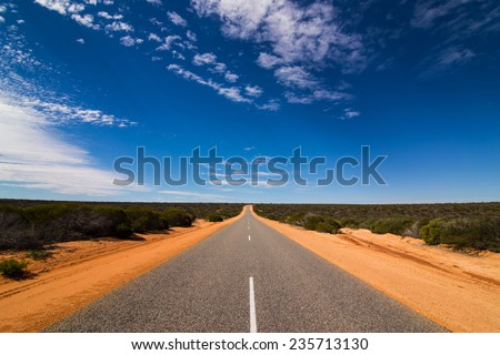 On the road through the western australian outback - stock photo