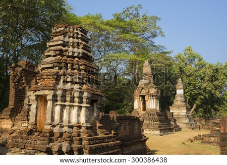 On the ruins of the ancient temple of Wat Chedi Chet Thaeo. Si Satchanalai, Thailand