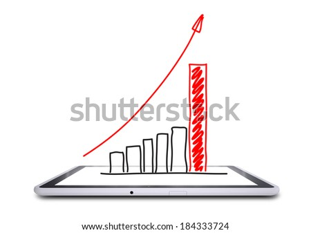 On the screen of the tablet is a growth graph. Concept of success - stock photo