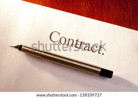 on the table a pen and paper to sign a contract