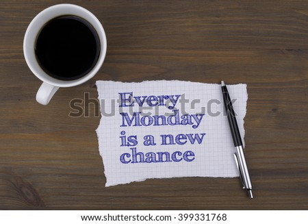 On the table cup of coffee with a piece of paper and text - Every Monday is a new chance - stock photo