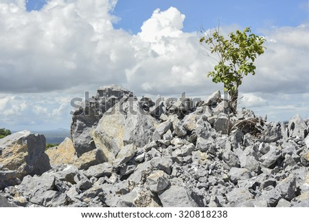 on the top of limestone quarry with blue sky - stock photo