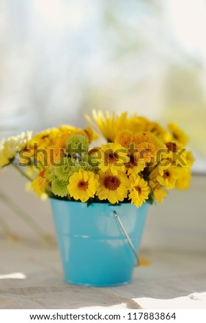 on the window sill in the sun bouquet of yellow flowers - stock photo