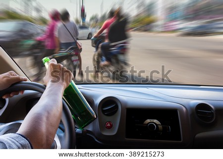 On the windshield ,man drink and drive have blur image of accident in the road as background.