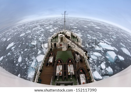 On Top of the World. Fish-eye lens view of sea ice off the coast of Spitsbergen (Svalbard Islands) in the High Arctic (78 degrees north) - stock photo