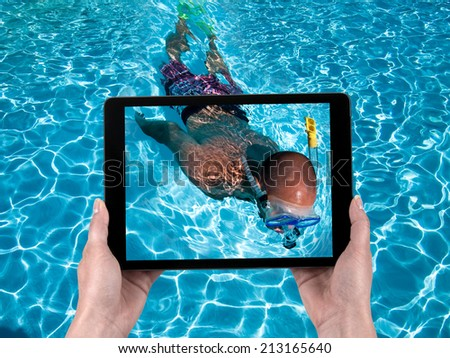 On vacation with the tablet - stock photo