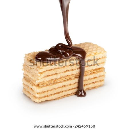 on vanilla wafer pouring chocolate on white background - stock photo