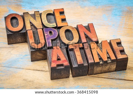 once upon a time opening phrase - storytelling concept  - text in vintage letterpress wood type against grunge painted wood - stock photo