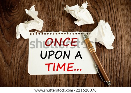 Once upon a time written on a paper - stock photo
