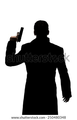 One action hero man's silhouette with a handgun. - stock photo
