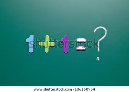 one add one on blackboard, concept of think different - stock photo
