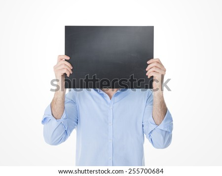 one adult holding a black banner in front of his head - stock photo