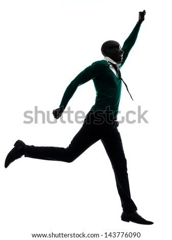 one african  black man  jumping happy  in silhouette studio on white background - stock photo