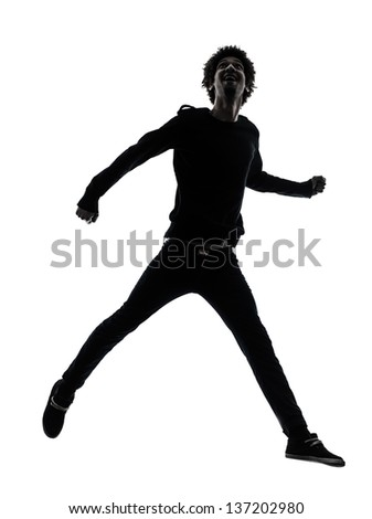 one african handsome young man jumping   in silhouette studio isolated on white background - stock photo