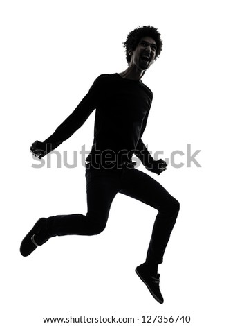 one african handsome young man jumping screaming  in silhouette studio isolated on white background - stock photo